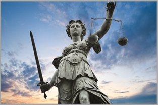 Lady Justice holding the scales of justice and the sword of truth